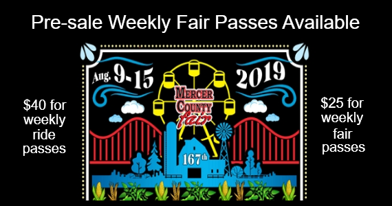 Image of a silhouette of a barn, silo, and a windmill in front